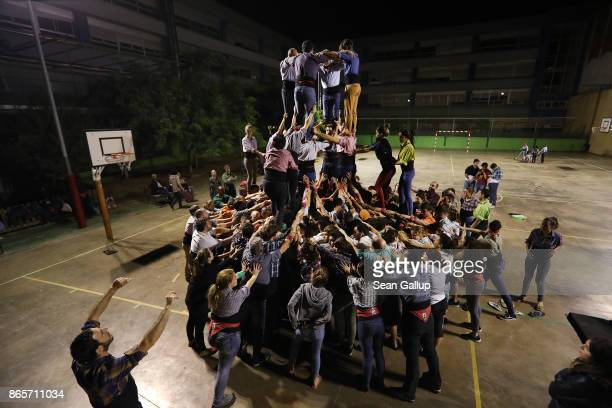 Pere Camprorin coach of the Castellers de Sants human tower group gives commands to 'castellers' the term for members of the group as they build a...