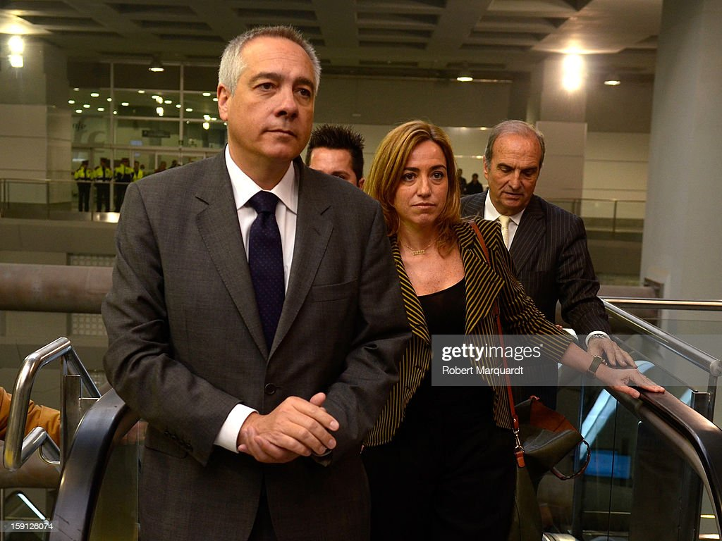 Pere Navarro (L) and Carme Chacon arrive at the Girona train station for the inauguration of the AVE high-speed train line between Barcelona and the French border on January 8, 2013 in Barcelona, Spain.