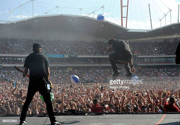 Peredur ap Gwynedd and Ben 'The Verse' Mount of Pendulum perform on stage at the Homebush Olympic Venue during Big Day Out Sydney viewed from the...