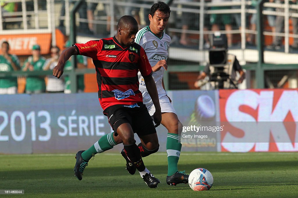 Pereira, from Sport, and Vinicius, from Palmeiras, fight for the ball during the match between Palmeiras and Sport for the Brazilian Series B 2013 at Pacaembu stadium on September 21, 2013 in Sao Paulo, Brazil.