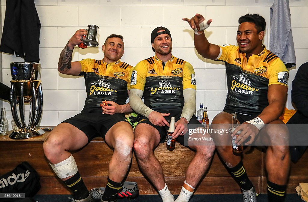 Perenara Cory Jane and Julian Savea of the Hurricanes celebrate in the changing room after the Hurricanes won the 2016 Super Rugby Final match...