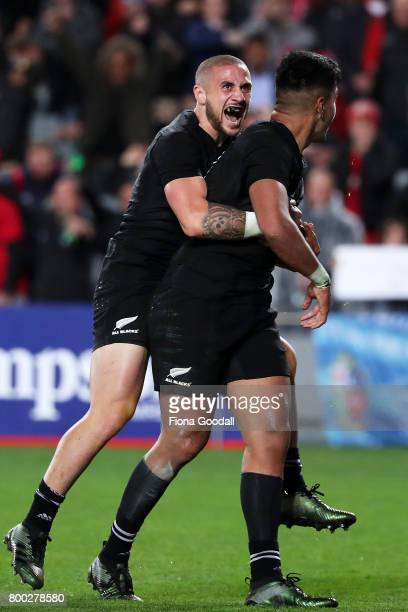 Perenara of the All Blacks celebrates with Rieko Ioane after a try during the Test match between the New Zealand All Blacks and the British Irish...