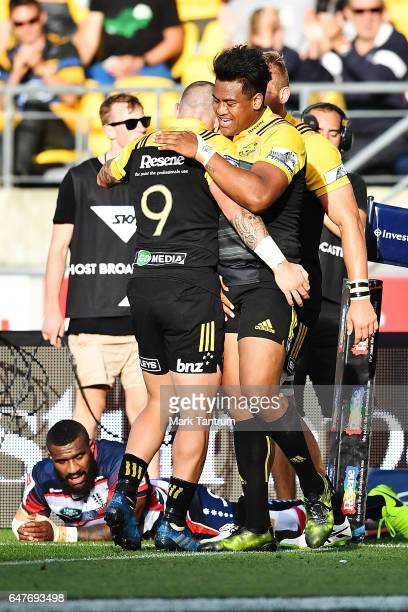 Perenara of the Hurricanes congratulates Julian Savea of the Hurricanes during the round two Super Rugby match between the Hurricanes and the Rebels...