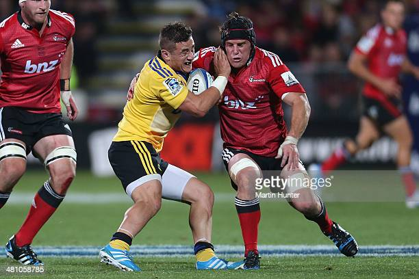 Perenara of the Hurricanes is tackled by Matt Todd of the Crusaders during the round seven Super Rugby match between the Crusaders and the Hurricanes...