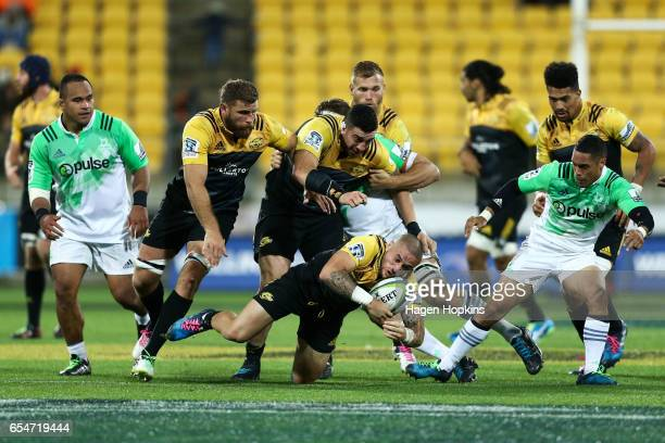 Perenara of the Hurricanes loses his footing during the round four Super Rugby match between the Hurricanes and the Highlanders at Westpac Stadium on...