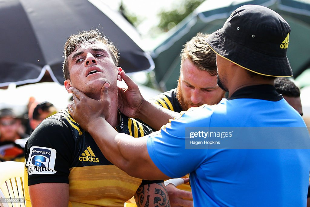 TJ Perenara of the Hurricanes sits on the bench after sustaining an injury during the Super Rugby pre-season match between the Blues and the Hurricanes at Eketahuna Rugby Club on February 13, 2016 in Eketahuna, New Zealand.