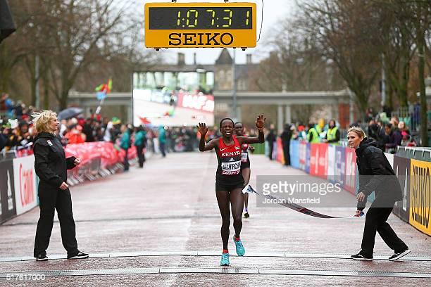 Peres Jepchirchir of Kenya crosses the line to win the Women's Half Marathon during the IAAF/Cardiff University World Half Marathon Championships on...