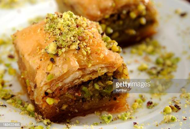 Perfect baklava with pistachio arranged on a white plate
