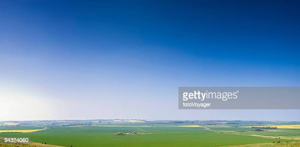 Perfect blue sky over green landscape