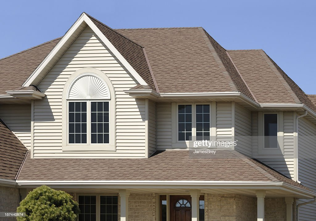 Perfect brown home with gabled architectural asphalt roof for Architectural siding