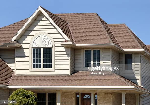 Perfect Brown Home With Gabled Architectural Asphalt Roof, Vinyl Siding