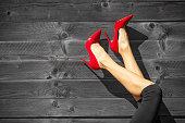 Sexy women's legs in red high heels.