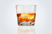 Perfect glass of whiskey and ice isolated on white background. Clipping path