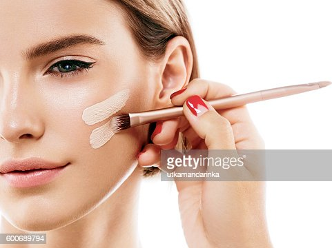Perfect makeup. Skin tone cream lines on woman face. : Stock-Foto
