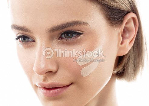 Perfect makeup. Skin tone cream lines on woman face. : ストックフォト