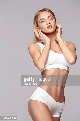 Perfect slim toned young body of the girl . : Stock Photo