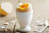 Perfect soft boiled egg on a table. Traditional food for healthy breakfast. Close-up shot.