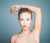 Perfect Spa Model Girl with Healthy Skin on Blue Background. Spa Beauty Portrait