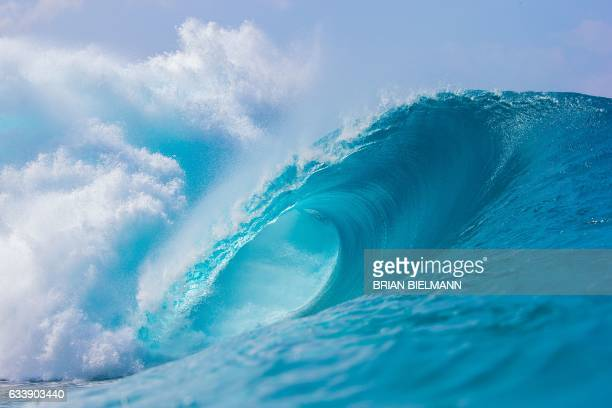 A perfect wave is pictured during the 2017 Volcom Pipe pro at Pipeline February 4 on the North shore of Oahu Island in Hawaii The Banzai Pipeline or...