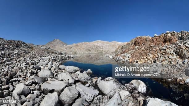 Perfectly blue lake in a barren rocky landscape