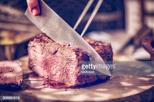 Perfectly Roasted Roast Beef Cut into Slices : Stock Photo
