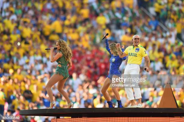 Perfomers Jennifer Lopez Claudia Leitte and Pitbull perform during the Opening Ceremony of the 2014 FIFA World Cup Brazil prior to the Group A match...