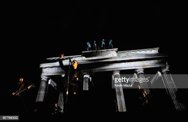 U2 perform during a concert in front of the Brandenburg Gate the on November 5 2009 in Berlin Germany U2 performed a free concert in collaboration...