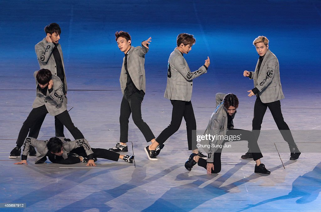 EXO perform during the opening ceremony for the Opening Ceremony ahead of the 2014 Asian Games at Incheon Asiad Stadium on September 19 2014 in...