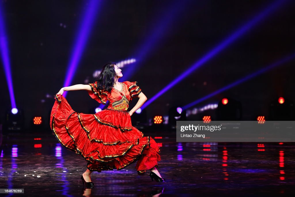 A perform entertains during the G VILL Mark Cheung Shoes Collection on the second day of Mercedes-Benz China Fashion Week Autumn/Winter 2013/2014 at 751D.Park Tank Zone on March 25, 2013 in Beijing, China.
