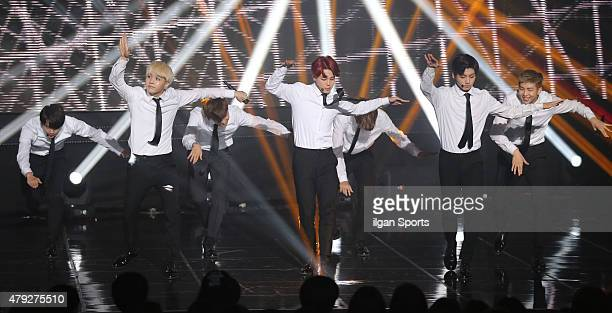 BTS perform onstage during SBS MTV 'The Show' at SBS Prism Tower on June 30 2015 in Seoul South Korea