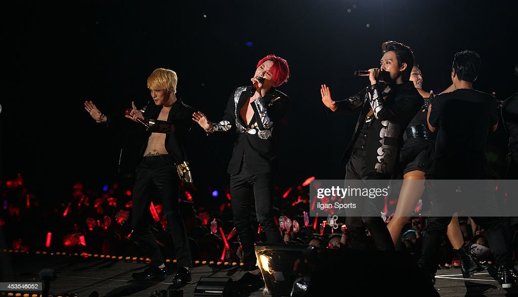<a gi-track='captionPersonalityLinkClicked' href=/galleries/search?phrase=JYJ&family=editorial&specificpeople=3039772 ng-click='$event.stopPropagation()'>JYJ</a> perform onstage during their 2014 asia tour 'THE RETURN OF THE KING' at Jamsil sports complex on August 9, 2014 in Seoul, South Korea.