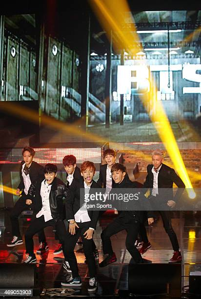 BTS perform onstage during their showcase at Lotte Card Art Center on February 11 2014 in Seoul South Korea