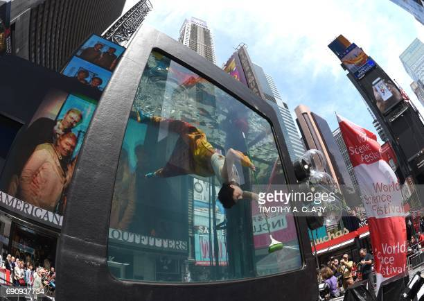 TOPSHOT Performance artist Annie Saunders performs ' Cleaning' during a press preview from Holoscenes a performanceinstallation in Times Square on...