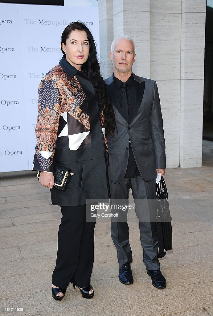 Performance artist Marina Abramovic (L) and director of MoMa PS1 Klaus Biesenbach attend the season opening performance of Tchaikovsky's 'Eugene Onegin' at The Metropolitan Opera House on September 23, 2013 in New York City.