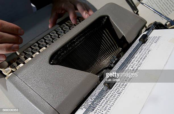 Performance artist Tim Youd uses a Royal Quiet Deluxe typewriter to transcribe Charles Bukowski's novel 'Factotum' in front of the US Postal Service...