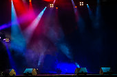 Concert stage. Beautiful Colourful disco lighting in the stage. Performance moving lighting. Concert Light Show. Stage Lights.