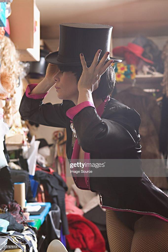 Performer adjusting her top hat : Stock Photo