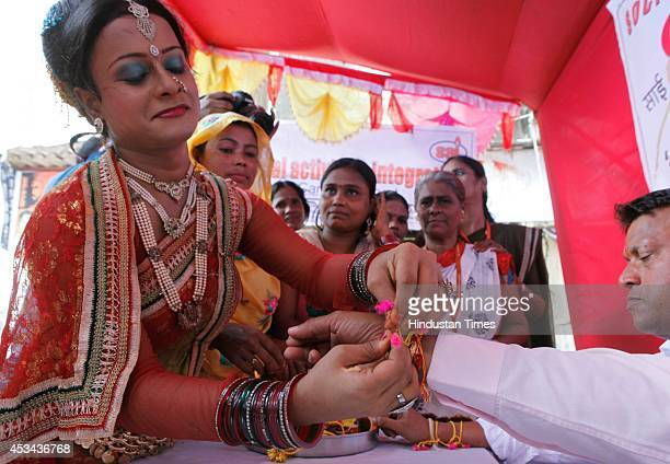 A performer along with the sex workers tie the Rakhis to the NGO activists during an event held on the occasion of Raksha Bandhan organized by the...