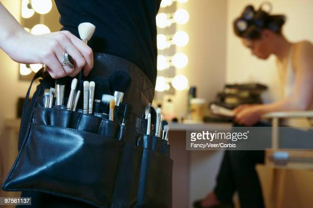 Performer and makeup artist in a dressing room