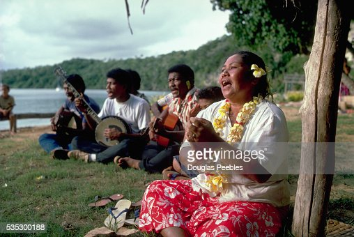 Performer Clapping and Singing With Musicians at Tongan Feast