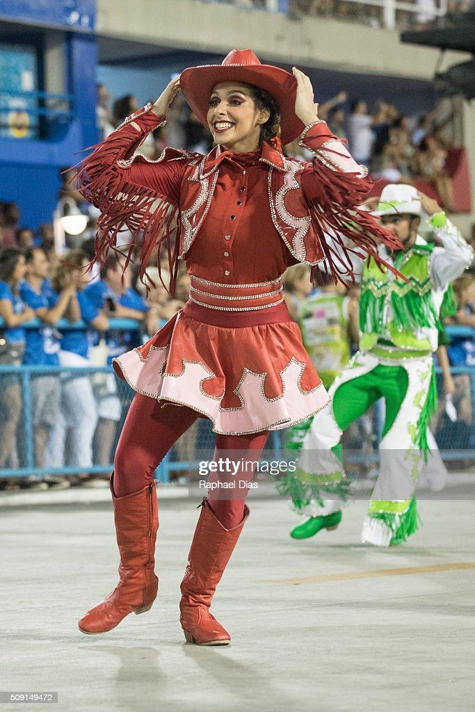 A performer dances during Imperatriz Leopoldinense performance at the Rio Carnival in Sambodromo on February 8, 2016 in Rio de Janeiro, Brazil. Despite the Zika virus epidemic, thousands of tourists gathered in Rio de Janeiro for the carnival.
