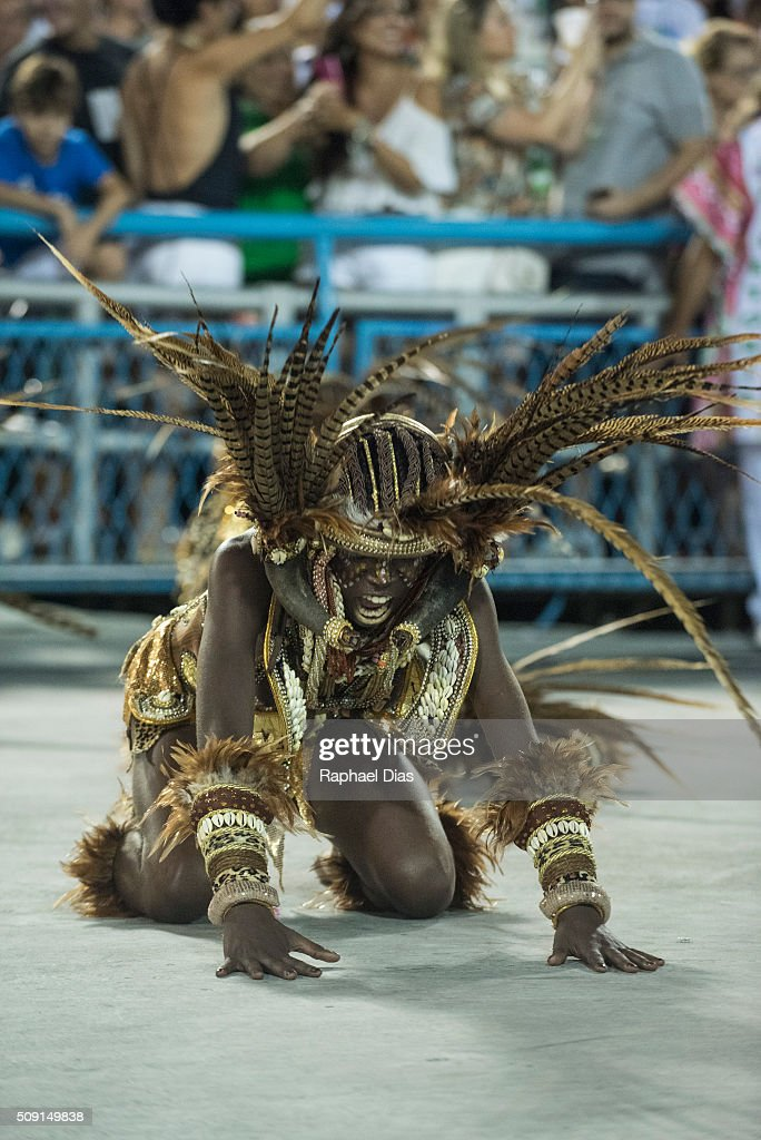 A performer dances during Mangueira performance at the Rio Carnival in Sambodromo on February 8, 2016 in Rio de Janeiro, Brazil. Despite the Zika virus epidemic, thousands of tourists gathered in Rio de Janeiro for the carnival.