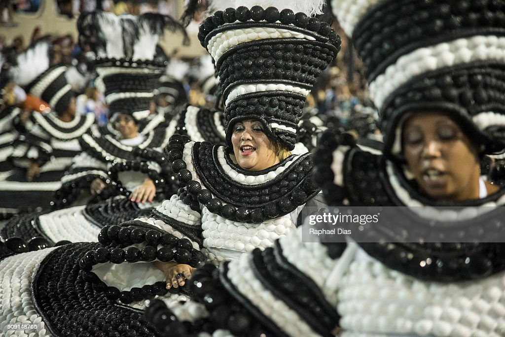 A performer dances during Portela performance at the Rio Carnival in Sambodromo on February 8, 2016 in Rio de Janeiro, Brazil. Despite the Zika virus epidemic, thousands of tourists gathered in Rio de Janeiro for the carnival.