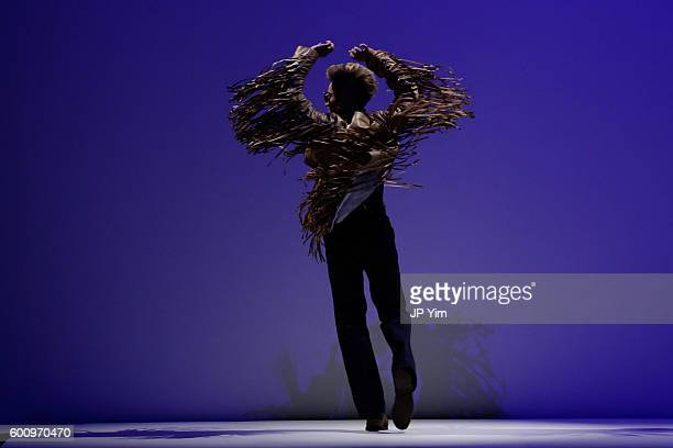 A performer dances on the runway at the Malan Breton fashion show during New York Fashion Week September 2016 at Hammerstein Ballroom on September 8...