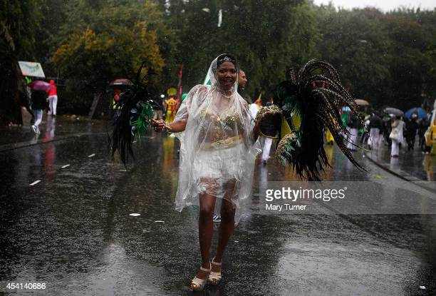 A performer dances through heavy rain during the Notting Hill Carnival on August 25th 2014 in London England Despite the bad weather over 1 million...