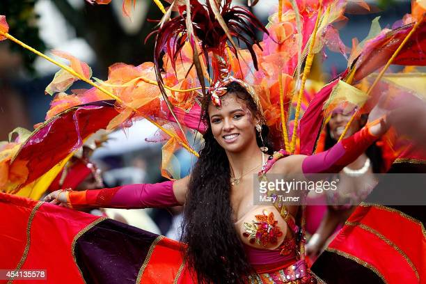 A performer dances through the rain during the Notting Hill Carnival by on August 25th 2014 in London England Despite the bad weather over 1 million...