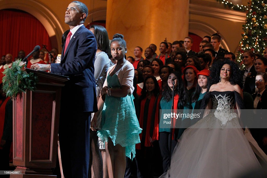 Performer Diana Ross (R) watches as U.S. President Barack Obama speak during the 'Christmas in Washington' concert at the National Building Museum on December 9, 2012 in Washington, D.C. The concert benefits the National Childrens Medical Center and is hosted by comedian Conan O'Brien.