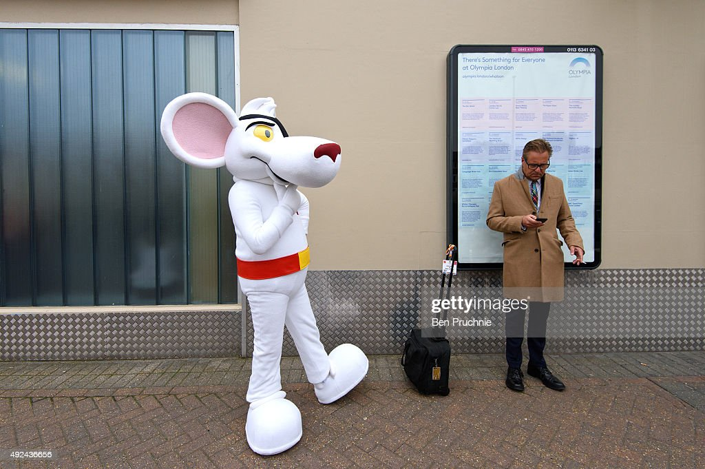 A performer dressed as Danger Mouse waits outside the Olympia after the Brand Licensing Europe character parade at Olympia Exhibition Centre on October 13, 2015 in London, England. A record number of famous children's characters will take part in this year's character parade during the 17th edition of the annual Brand Licensing Europe exhibition. The event, which is dedicated to licensing and brand extension, will take place between October 13 and October 15 with over 2,200 worldwide properties on show.