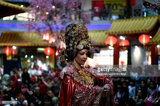 TOPSHOT A performer dressed as Empress Huang of the China's Forbidden City takes part in a musical performance at a shopping mall in Kuala Lumpur on...