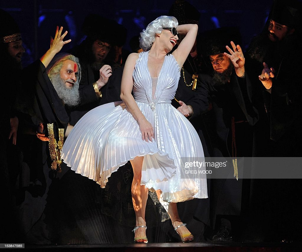 A performer dressed as Marilyn Monroe reacts during the 'Dance of the Seven Veils' in a full dress rehearsal for the Opera Australia production of 'Salome' at the Sydney Opera House on October 10, 2012. Salome, which opens in Sydney on October 12, is an explosive and outrageous story of sex, death and religion and includes the famous 'Dance of the Seven Veils' featuring seven mini dance routines. AFP PHOTO / Greg WOOD